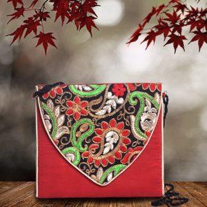 Embroidered silk sling bag